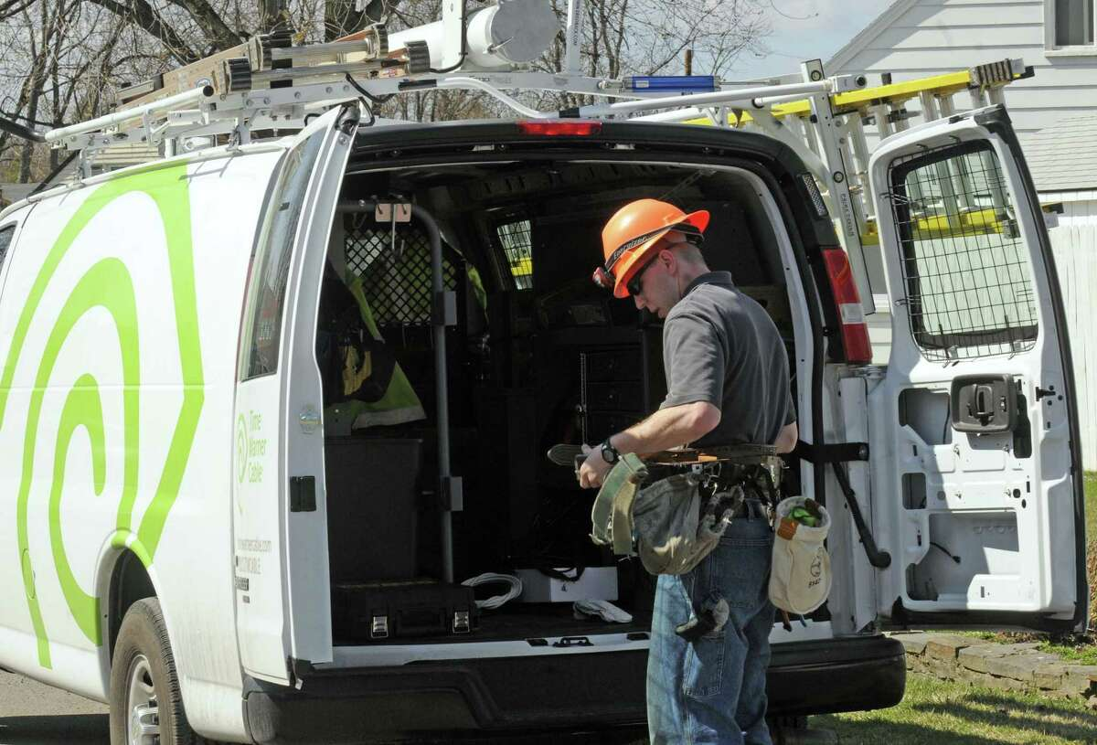 Time Warner technician Adam Smith prepares to work on cable lines in Latham, NY Thursday March 22, 2012. ( Michael P. Farrell/Times Union )