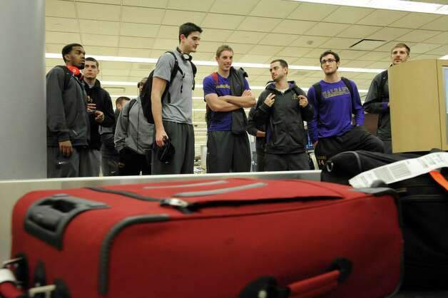 The UAlbany men's basketball team, which upset Washington on Tuesday night, returns  from Seattle and waits for their luggage at the Albany International Airport on Wednesday, Nov. 14, 2012 in Albany, N.Y.  (Lori Van Buren / Times Union) Photo: Lori Van Buren
