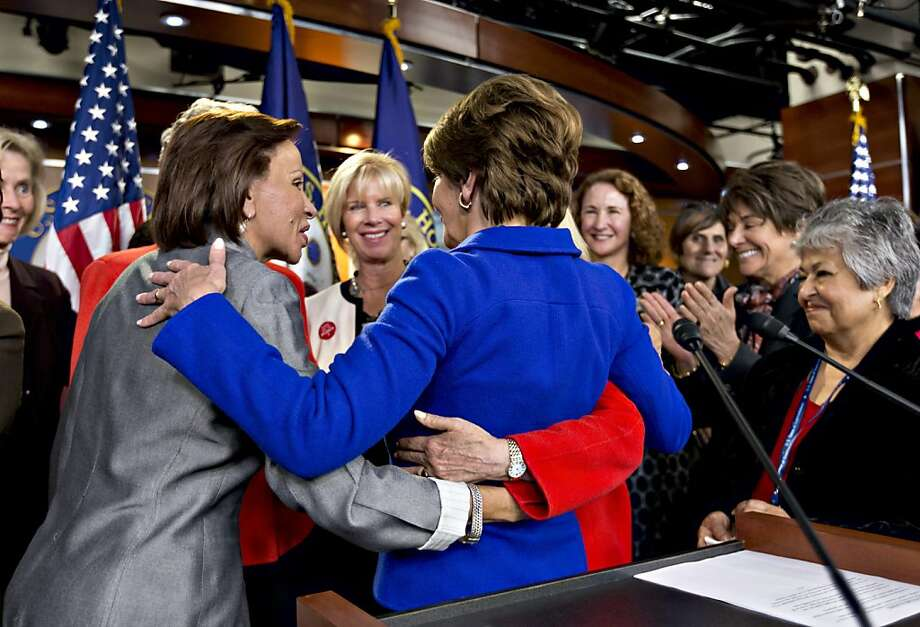 Rep. Nydia Velazquez, D-N.Y. (left), and other colleagues congratulate Nancy Pelosi (back to camera) on Thursday. Photo: J. Scott Applewhite, Associated Press