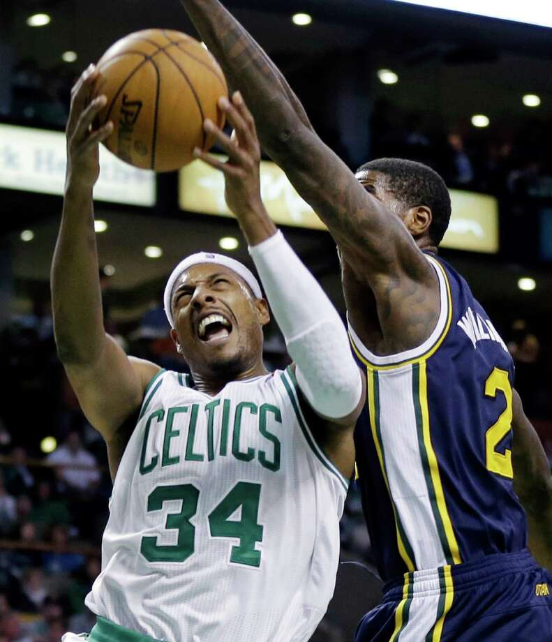 Boston Celtics forward Paul Pierce (34) drives to the hoop against Utah Jazz forward Marvin Williams (2) in the second half of an NBA basketball game in Boston, Wednesday, Nov. 14, 2012. The Celtics won 98-93. (AP Photo/Elise Amendola) Photo: Elise Amendola