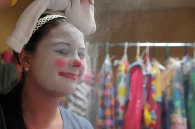 Advocate writer Maggie Gordon fixes her makeup with puffs of powder during week two of clown college at the Stamford Marriott in Stamford, Conn., Nov. 14, 2012. Gordon will be a clown during the USB balloon parade Sunday. Photo: Keelin Daly / Stamford Advocate Riverbend Stamford, CT