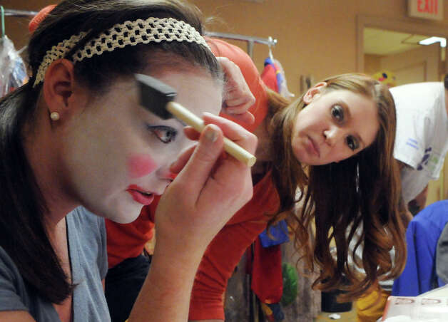 Professional clown coach Emily Season helps Advocate writer Maggie Gordon with her makeup during week two of clown college at the Stamford Marriott in Stamford, Conn., Nov. 14, 2012. Gordon will be a clown during the USB balloon parade Sunday. Photo: Keelin Daly / Stamford Advocate Riverbend Stamford, CT