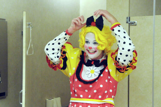 Advocate writer Maggie Gordon adjusts her hair bow during week two of clown college at the Stamford Marriott in Stamford, Conn., Nov. 14, 2012. Gordon will be a clown during the USB balloon parade Sunday. Photo: Keelin Daly / Stamford Advocate Riverbend Stamford, CT