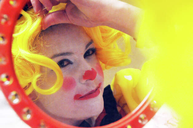 Advocate writer Maggie Gordon adjusts her wig during week two of clown college at the Stamford Marriott in Stamford, Conn., Nov. 14, 2012. Gordon will be a clown during the USB balloon parade Sunday. Photo: Keelin Daly / Stamford Advocate Riverbend Stamford, CT