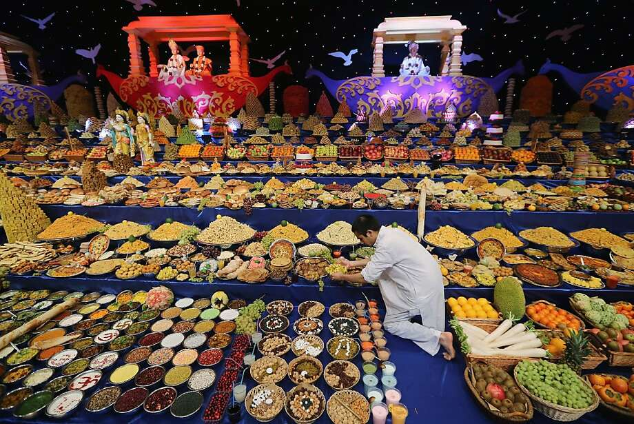 Food is placed on the main stage as Sadhus and Hindu men celebrate Diwali at the BAPS Shri Swaminarayan Mandir on November 14, 2012 in London, England. Diwali, which marks the start of the Hindu New Year, is being celebrated by thousands of Hindu men women and children in the Neasden mandir, which was the first traditional Hindu temple to open in Europe. Photo: Dan Kitwood, Getty Images