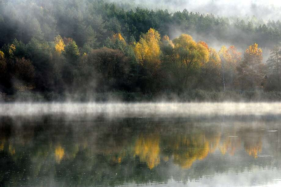 Morning mist floats above the water of Lake Orfu, decorated with autumn colours, at Orfu, 206 kms south of Budapest, Hungary, Wednesday, Nov. 14, 2012. Photo: Ferenc Kalmandy, Associated Press