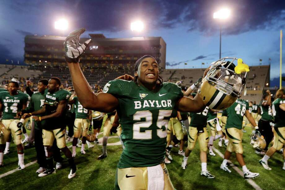 Baylor running back Lache Seastrunk (25) celebrates their 41-14 win over Kansas following an NCAA college football game on Saturday, Nov. 3, 2012, in Waco, Texas. (AP Photo/Waco Tribune Herald, Jerry Larson) Photo: Michael Bancale, MBO / Waco Tribune Herald