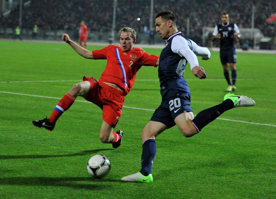 Ex-Dynamo defender Geoff Cameron, right, played for the U.S. against Russia in November. Cameron's career took off after a good January 2012 U.S. camp. Photo: STR / AFP