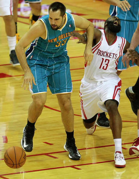 James Harden, right, shakes off a Ryan Anderson elbow to the face to turn in a 30-point performance Wednesday night at Toyota Center. Photo: Billy Smith II, Staff / © 2012 Houston Chronicle