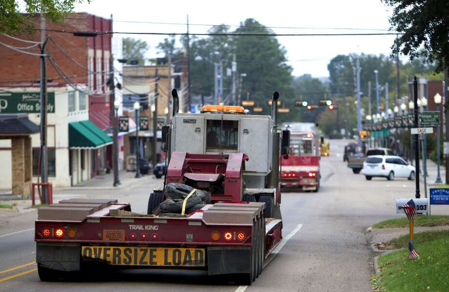 Trucks that haul equipment for TransCanada's Keystone XL project drive through downtown Winnsboro, Texas Thursday, Oct. 25, 2012, in Wood County. (Houston Chronicle)