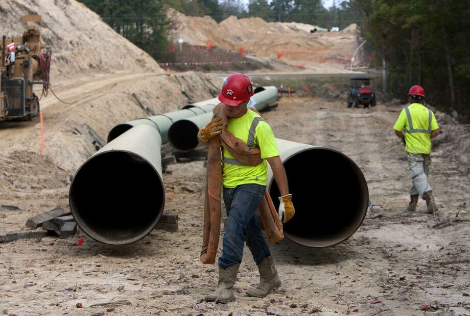 Crewmen work a site for TransCanada's Keystone XL project in Wood County, Wednesday, Oct. 24, 2012, in Winnsboro, Texas. (Cody Duty / Houston Chronicle) (Houston Chronicle)