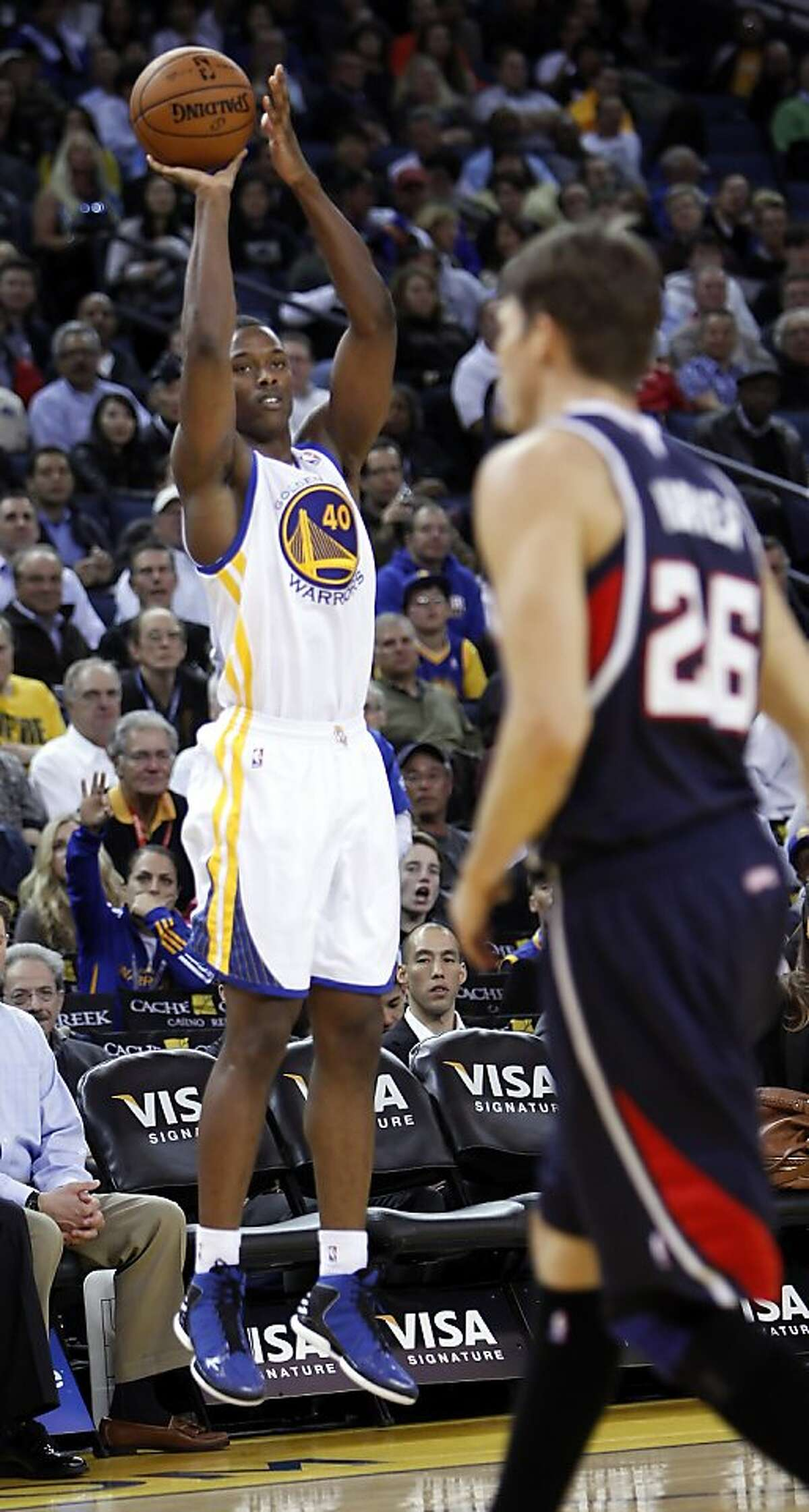 Harrison Barnes puts up a shot in the first quarter as the Golden State Warriors played the Atlanta Hawks at Oracle Arena in Oakland, Calif., on Wednesday, November 14, 2012.