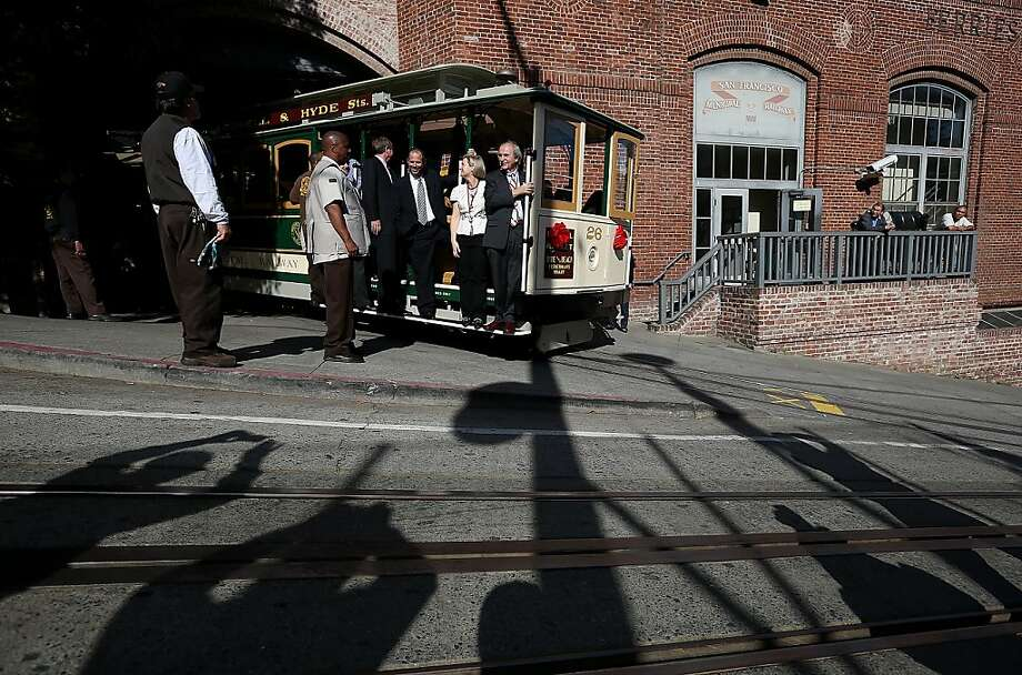 People take pictures as San Francisco Cable Car #26 pulls out of the barn during a service inauguration ceremony for the newly restored vintage Cable Car on November 14, 2012 in San Francisco, California.  A service inauguration ceremony kicked off a new life for San Francisco Cable Car #26 that was originally built in 1890 and has been fully restored by hand and put back in service on the streets of San Francisco. Photo: Justin Sullivan, Getty Images
