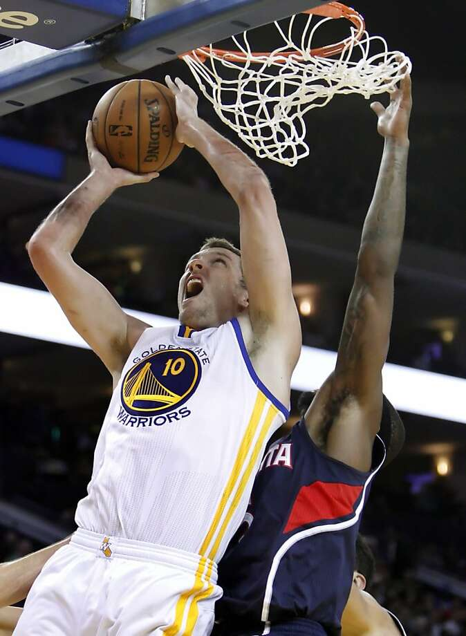 Warriors forward David Lee puts up a shot in the second period as the Golden State Warriors played the Atlanta Hawks at Oracle Arena in Oakland, Calif., on Wednesday, November 14, 2012. Photo: Carlos Avila Gonzalez, The Chronicle