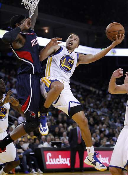 Stephen Curry puts up a shot in the second quarter as the Golden State Warriors played the Atlanta H