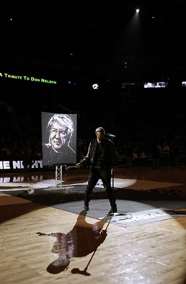 Artist David Garibaldi paints a tribute to Warriors and Hall of Fame coach Don Nelson during halftime as the Golden State Warriors played the Atlanta Hawks at Oracle Arena in Oakland, Calif., on Wednesday, November 14, 2012. Photo: Carlos Avila Gonzalez, The Chronicle