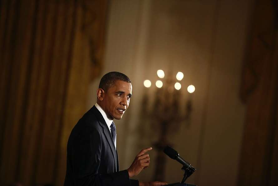 President Obama answers questions at the White House.