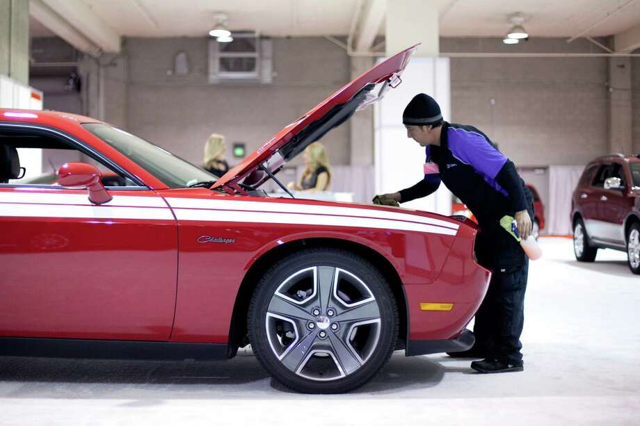 A Dodge Challenger is detailed on Wednesday, November 14, 2012 during the opening day of the Seattle Auto Show at CenturyLink Field Events Center. Photo: JOSHUA TRUJILLO / SEATTLEPI.COM
