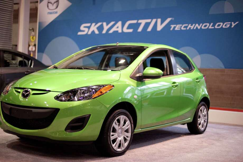 A Mazda 2 is shown on Wednesday, November 14, 2012 during the opening day of the Seattle Auto Show at CenturyLink Field Events Center. Photo: JOSHUA TRUJILLO / SEATTLEPI.COM