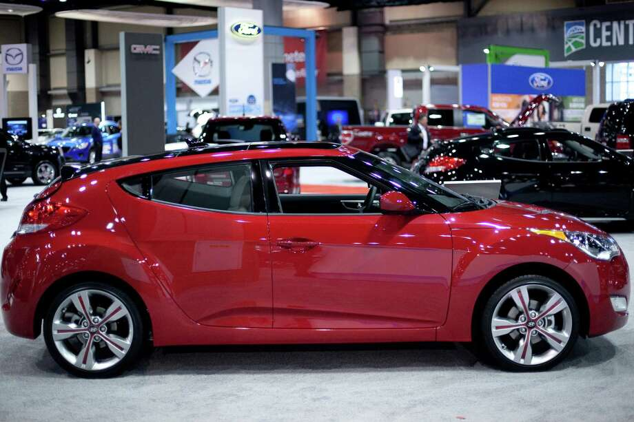 The Hyundai Veloster is shown on Wednesday, November 14, 2012 during the opening day of the Seattle Auto Show at CenturyLink Field Events Center. Photo: JOSHUA TRUJILLO / SEATTLEPI.COM