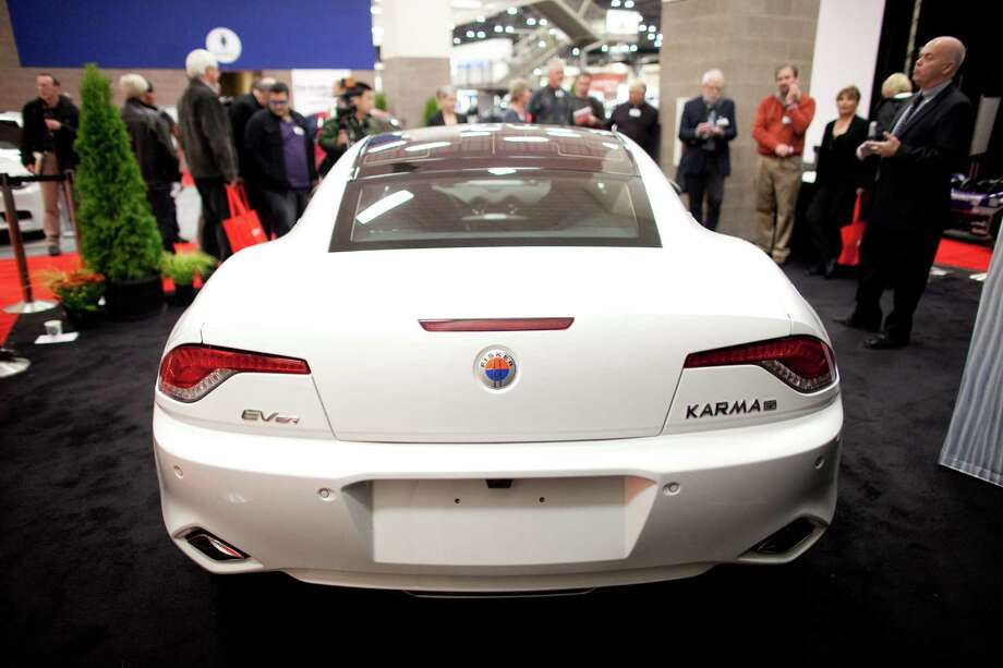 An electric Fisker Karma is shown on Wednesday, November 14, 2012 during the opening day of the Seattle Auto Show at CenturyLink Field Events Center. Photo: JOSHUA TRUJILLO / SEATTLEPI.COM