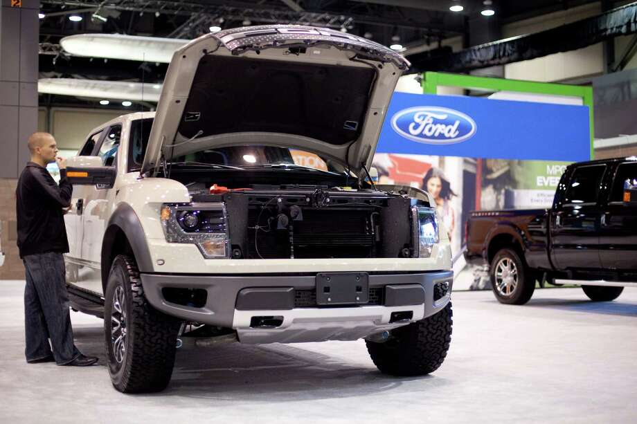 A Ford F-150 Raptor SVT is shown on Wednesday, November 14, 2012 during the opening day of the Seattle Auto Show at CenturyLink Field Events Center. Photo: JOSHUA TRUJILLO / SEATTLEPI.COM