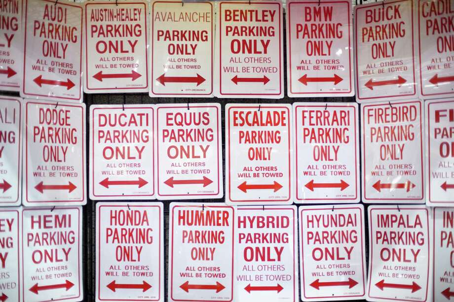 No parking signs are shown on Wednesday, November 14, 2012 during the opening day of the Seattle Auto Show at CenturyLink Field Events Center. Photo: JOSHUA TRUJILLO / SEATTLEPI.COM