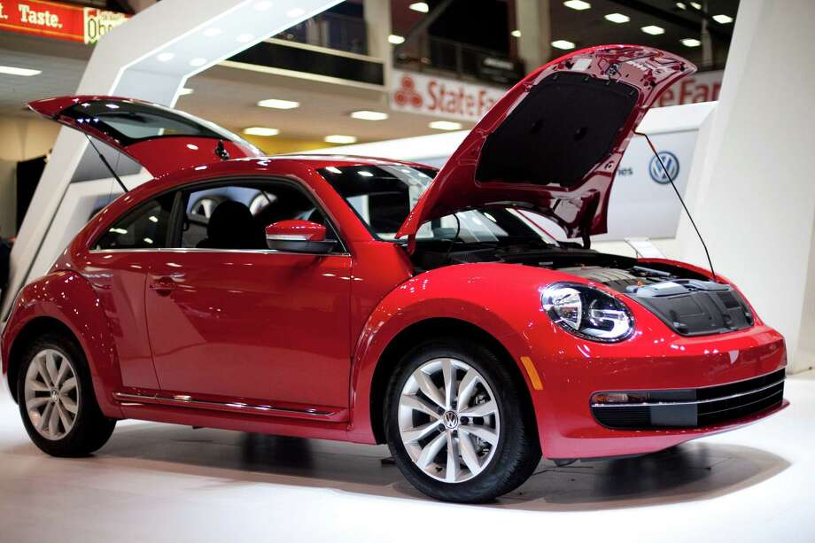 A VW Beetle is shown on Wednesday, November 14, 2012 during the opening day of the Seattle Auto Show at CenturyLink Field Events Center. Photo: JOSHUA TRUJILLO / SEATTLEPI.COM