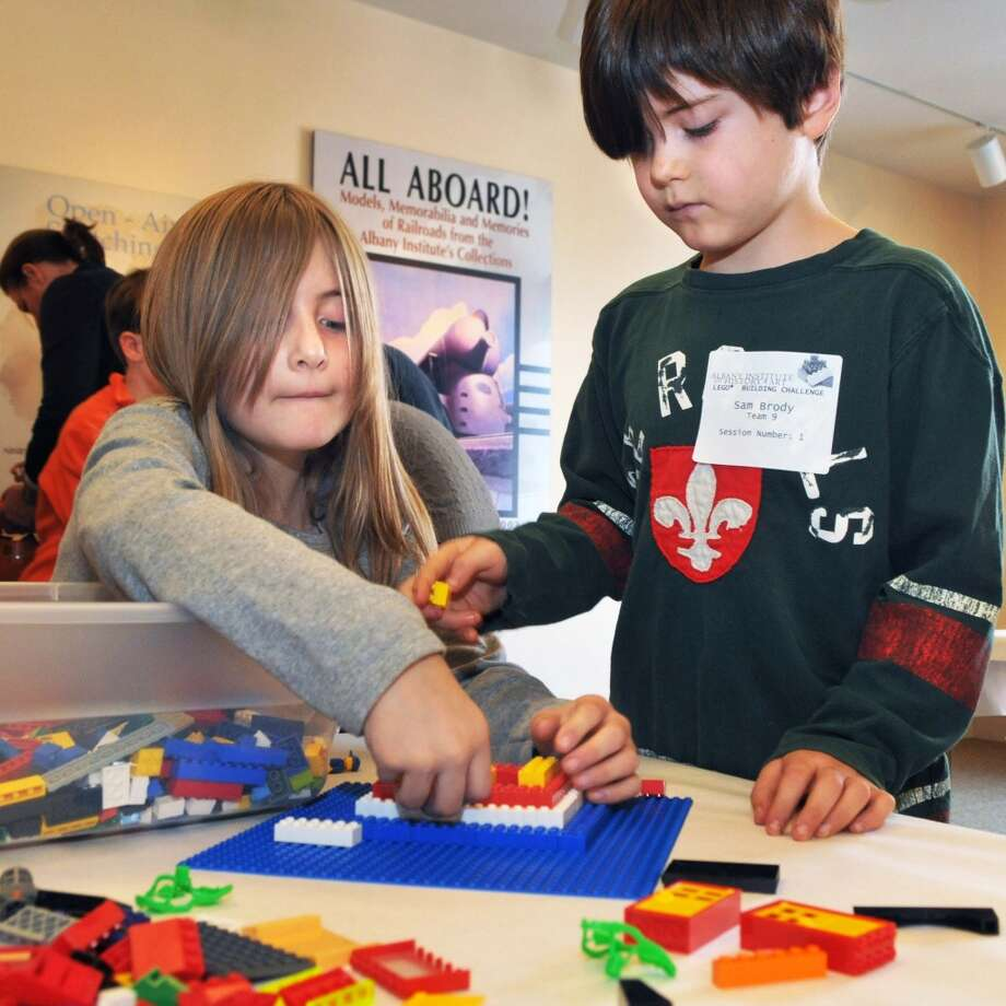 Sister and brother, Grace,10, left, and Sam Brody,9, of Castleton compete in the LEGO�® Building Challenge at the 2011 Gift Fair & Family Festival at the Albany Institute of History & Art Friday Nov. 25, 2011.    (John Carl D'Annibale / Times Union) (Albany Times Union)