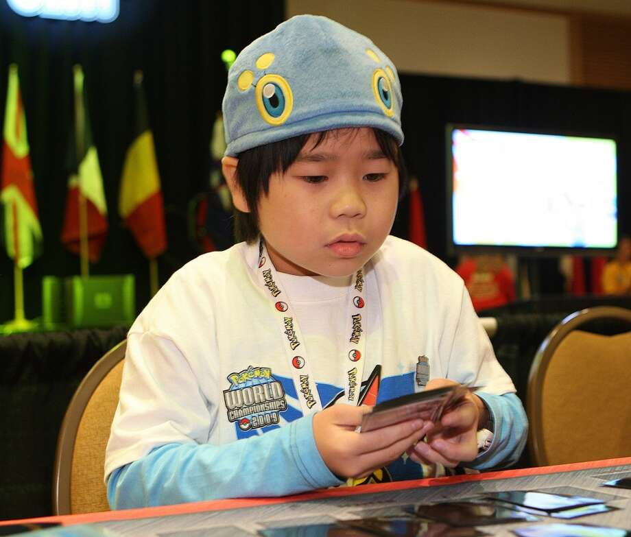 COMMERCIAL IMAGE: In this photograph taken by AP Images for Pokémon, Kakeru Takemura, age 11, of Japan contemplates his next move against his opponent at the 2009 Pokémon World Championships at the Hilton Bayfront in San Diego. Takemura is competing in the two-day event in hopes of securing the title of Pokémon Trading Card Game World Champion. First-place winners are awarded a World Champion trophy, a prize kit containing a variety of Pokémon merchandise, and the coveted invitation to compete in the 2010 World Championships.  Friday, August 14, 2009 in San Diego, Calif. (Shea Walsh / AP Images for Pokémon) (AP IMAGES FOR POKEMON)