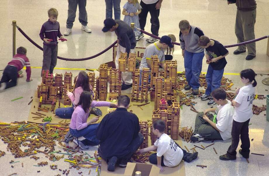 A world record Lincoln Log structure is built in the lobby of the Sibley building in downtown Rochester, N.Y., Saturday Dec.15, 2001. The construction was organized by lifelong Lincoln Log fan Vern Larkin who said it would have more than 10, 000 logs when complete and would be recognized by Guinness World Records.  Lincoln Logs celebrate their 85th anniversary this year.   (AP Photo, Democrat and Chronicle, Will Yurman) (AP)