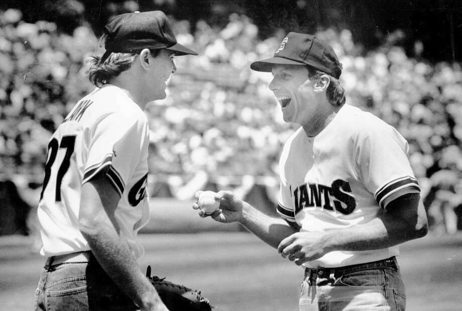 "May 31, 1987: Montana gives Clark his boyish ""Dude, we're throwing the first pitch at the Giants game!"" look at the San Francisco Giants game. Montana threw to Clark before a game against the Montreal Expos. Photo: Deanne Fitzmaurice, The Chronicle / ONLINE_YES"