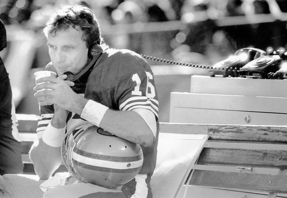 Jan. 1, 1989: Joe Montana on the phone in the first half of a 49ers game against the Vikings. Clark was already gone, so I imagine that Montana is calling Dwight. I love this photo with the old school phones. Photo: Scott Sommerdorf, The Chronicle / ONLINE_YES