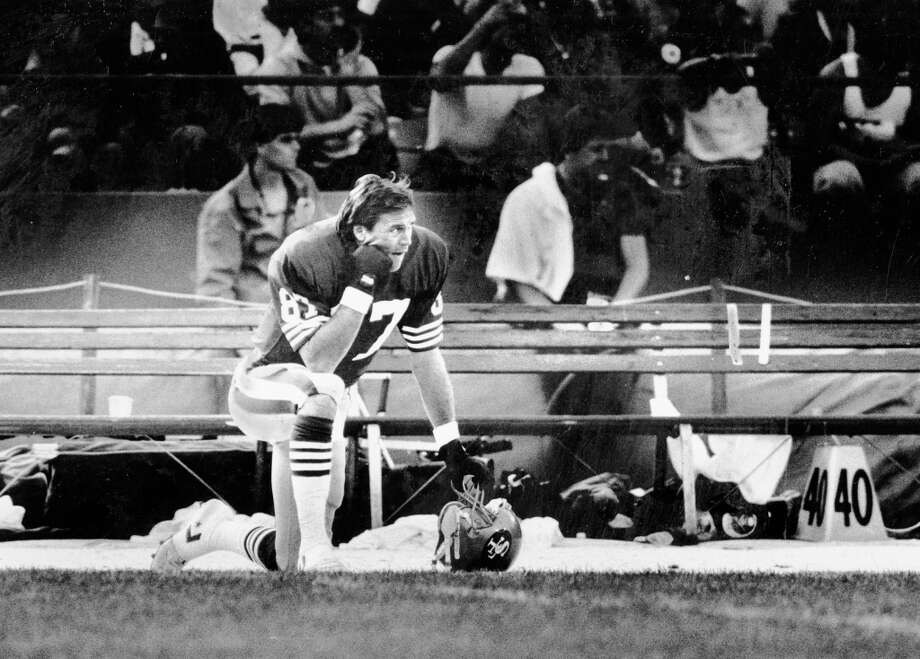 Nov. 7, 1987: Dwight Clark rests on the sideline during his tough final year as a 49er. The Bill Walsh offense emphasized spreading the ball around, but the 10th round draft choice still caught 50 or more passes in all but the first and last year of his nine-season career. Photo: Fred Larson, The Chronicle / ONLINE_YES