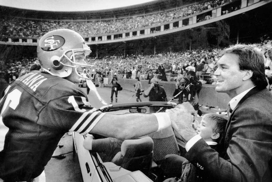 Dec. 11, 1988: Joe Montana greets Dwight Clark during a halftime ceremony honoring Clark, and retiring the wide receiver's jersey. Montana played 43 49ers games without Clark before moving to Kansas City. Photo: Fred Larson, The Chronicle / ONLINE_YES