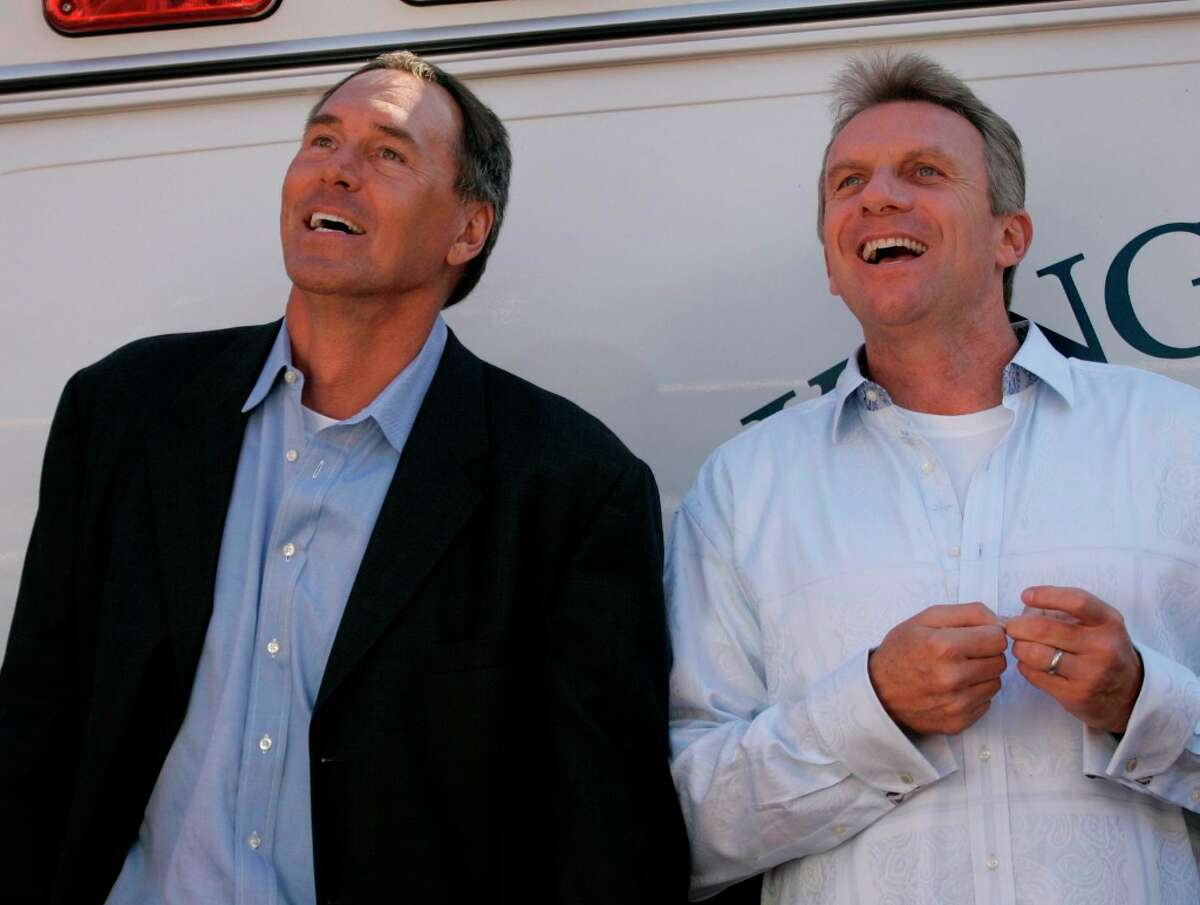 """Nov. 5, 2006: Dwight Clark and Joe Montana watch the big screen at Candlestick Park during a video clip of """"The Catch"""" -- honoring the 25th anniversary of the play."""