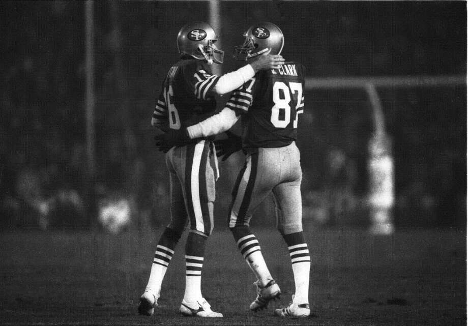 "Jan. 20, 1985: Montana Clark share a moment at Super Bowl XIX in Palo Alto. I'm hoping there was an ""I love you, man"" in there somewhere. Photo: Fred Larson, The Chronicle / SFC"