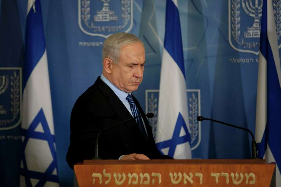 "Israel's Prime Minister Benjamin Netanyahu looks on after delivering a statement to the media at Hakirya a military base in Tel Aviv, Israel, Wednesday, Nov. 14, 2012. Israel's prime minister says the military is prepared to broaden its operation against Hamas targets in Gaza. Benjamin Netanyahu says Israel cannot tolerate continued rocket attacks against its citizens. In his first comments since Israel killed the commander of the Hamas military wing, Netanyahu said Wednesday that Israel is ""prepared to expand the operation"". (AP Photo/Ariel Schalit) Photo: Ariel Schalit"