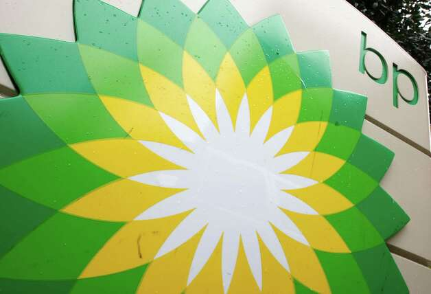 "FILE - In this file photo made Oct. 25, 2007, the BP (British Petroleum) logo is seen at a gas station in Washington. British oil company BP said Thursday Nov. 15, 2012 it is in advanced talks with U.S. agencies about settling criminal and other claims from the Gulf of Mexico well blowout two years ago. In a statement, BP said ""no final agreement has yet been reached"" and that any such deal would still be subject to court approvals.  (AP Photo/Charles Dharapak, File) Photo: Charles Dharapak, STF / AP"