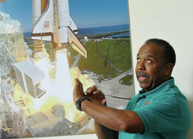 "Astronaut  Bernard Harris, right, explains what liftoff felt like as he  spends some time answering questions from the different team members.  The 6th-8th grade campers  participated in a ""space suit challenge"" at Lamar University as part of the ExxonMobil Bernard Harris Summer Science Camp, where they designed and created a space suit swatch capable of absorbing the impact of space debris. Dr. Bernard Harris' summer science camp is the largest of its kind in the nation and offers an all-expenses-paid, two-week experience for the selected local students. The designing and testing was held at the Dishman Art Museum on the Lamar Campus.  Dave Ryan/The Enterprise Photo: Dave Ryan"