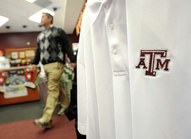 With the Aggie's recent win over Alabama, the school's merchandise has become a hot ticket item. Mitch Duncan sales manager at Games People Play walks past a section of Texas A&M shirts on Wednesday.  Photo taken Wednesday, November 14, 2012 Guiseppe Barranco/The Enterprise Photo: Guiseppe Barranco, STAFF PHOTOGRAPHER / The Beaumont Enterprise