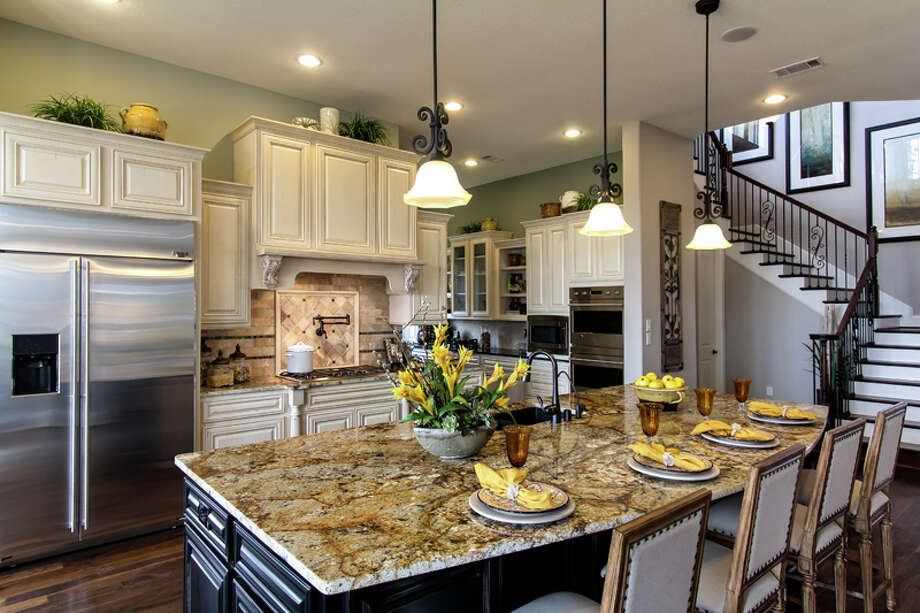 Creative kitchens take center stage in 12 new models priced from the $220,000s to $700,000s in West Houston?s Cinco Ranch. Shown is the kitchen of David Weekley?s Burleigh model in the new Sagewood neighborhood in Cinco Ranch. Photo: Connie Anderson, Owner | Photographer