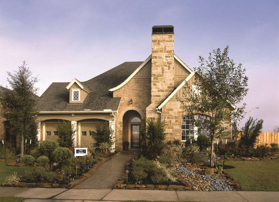 Four patio home models by David Weekley (shown) and Village Builders are grand opening at Cinco Ranch.