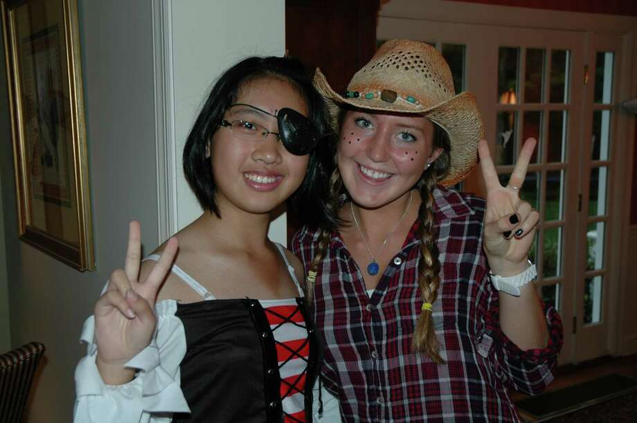 Chinese exchange student Sun Qinyuan and her Darien High School host sister, Katie Mulliken, celebrate Halloween during the exchange students' two week visit in October. Photo by Mac McDonough Photo: Contributed Photo