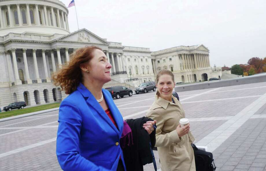 Democratic congresswoman-elect Elizabeth Esty, who was elected to office earlier this month, replacing Chris Murphy in the 5th Congressional District, and staff Julie Sweet, leave the Capitol in Washinton, D.C. after posing for the freshman group photo on Thursday, November 15, 2012. Photo: Jana Kasperkevic / News-Times