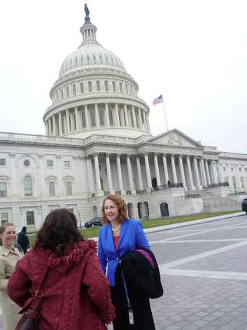 Democratic congresswoman-elect Elizabeth Esty, who was elected to office earlier this month, replacing Chris Murphy in the 5th Congressional District, and staffer Julie Sweet, talk to a constituent from Connecticut after posing for the freshman group photo at the Capitol in Washington, D.C. on Thursday, November 15, 2012. Photo: Jana Kasperkevic / News-Times