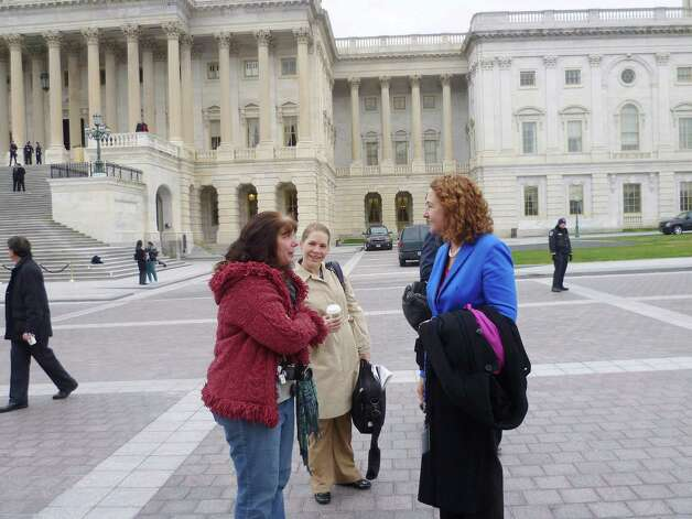 Democratic congresswoman-elect Elizabeth Esty, who was elected to office earlier this month, replacing Chris Murphy in the 5th Congressional District, speaks to a constituent from Connecitcut (who declined to be identified by name) after the freshman group photo on Thursday, November 15, 2012. Photo: Jana Kasperkevic / News-Times