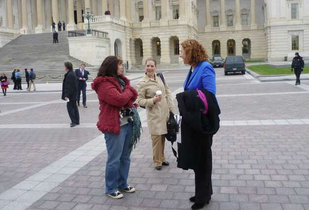 Democratic congresswoman-electElizabeth Esty, who was elected to office earlier this month, replacing Chris Murphy in the 5th Congressional District,  and staffer Julie Sweet, talk to a constituent from Connecticut (who declided to be identified by name) after Esty posed for the freshman group photo on Thursday, November 15, 2012. Photo: Jana Kasperkevic / News-Times