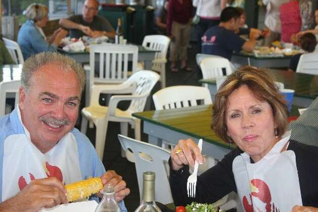 Mike and Sheryl Scully enjoy the popular food of choice in Maine -- lobster -- while visiting with Phil and Linda Hardberger for the Fourth of July.