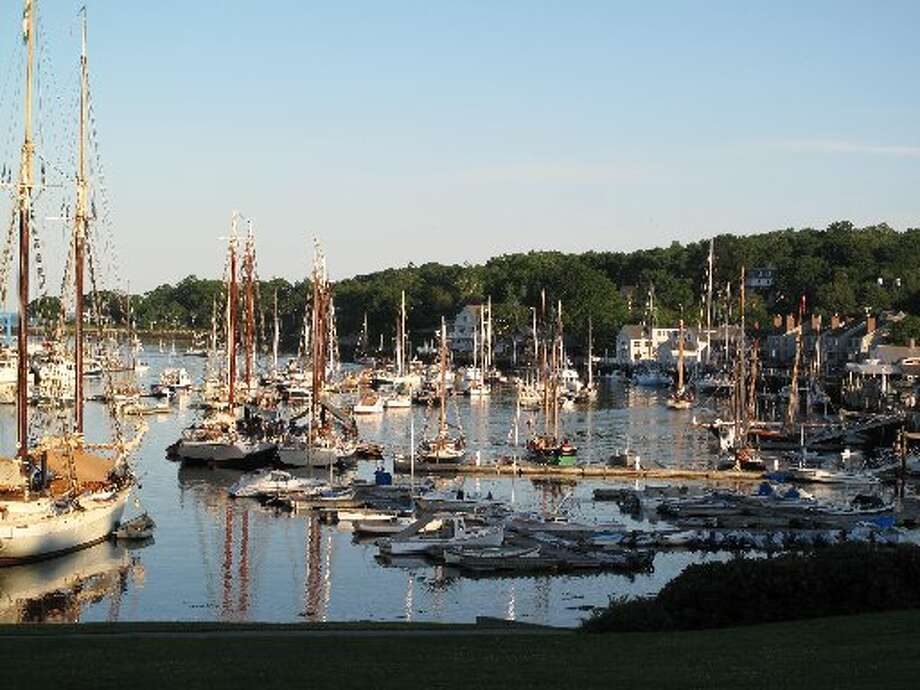 Boats of all sizes drop anchor or dock in Camden, Maine.